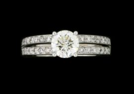 This 0.80ct diamond is set in two matching diamond pave bands.