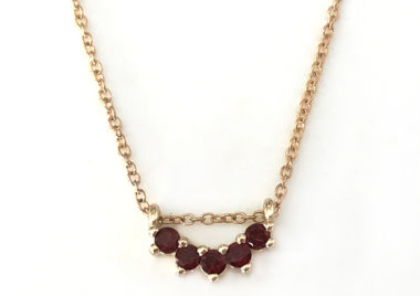 garnet 5 stone necklace in yellow gold